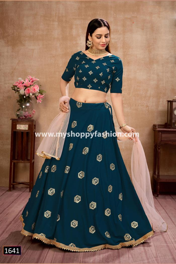 Teal Blue color Lehenga choli with peach dupatta